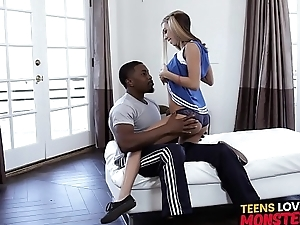 Luscious cheerleader stretched to the ground by black cock