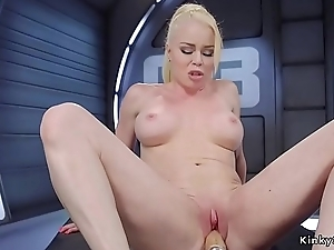 Busty blonde gets machine in shaved pussy