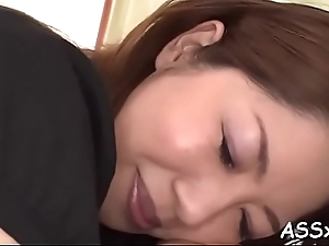 Sweet oriental enjoys wild bang with piles of anal riding