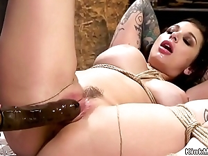 Dominate lesbian slave gets strap on in the ass