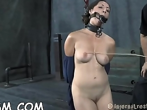 Tied up honey gets her pussy lips opened up for lusty torture