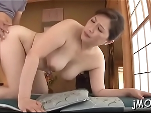 Beautiful asian older plays with water on her juicy pussy