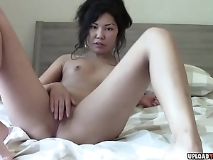 Asian belle fingering her cunt