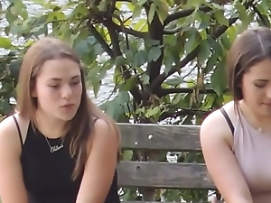 Three girls smoking and talking in a park