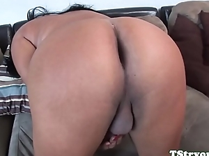 Curvy tgirl strokes her cock and spreads ass