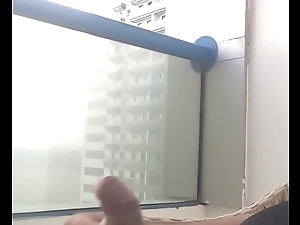 Cumshot on the balcony ... what a thrill ... in public view ... got caught ...
