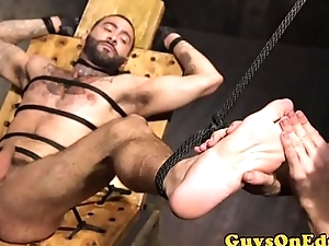 Tattooed stud gets edged by dom two