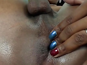 Nubian tgirl plays with her arse during solo